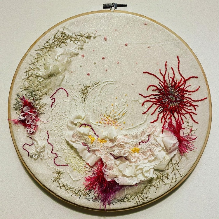 Embroidery of biological or botanical structures.